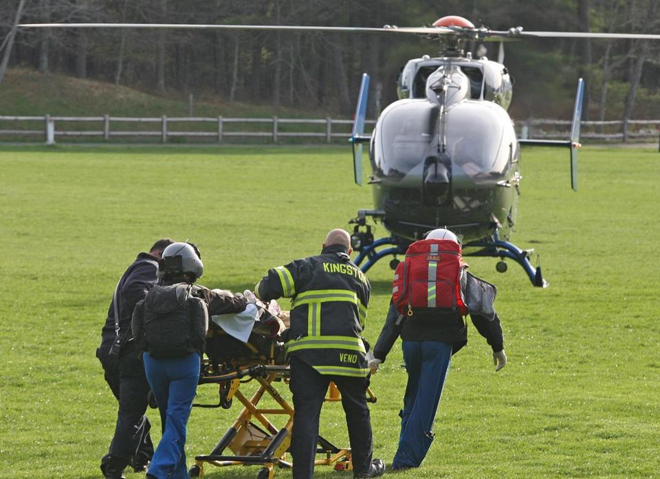 A female patient was transported to an awaiting medical helicopter at the nearby Sacred Heart High School.